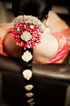South Indian bride. Temple jewelry. Jhumkis.Red silk kanchipuram sari.Braid with…