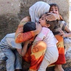 Mother comforting children