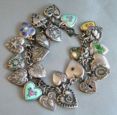 Fabulous collection of 23 vintage puffy heart charms bracelet enamels from stillfabulous on Ruby Lane