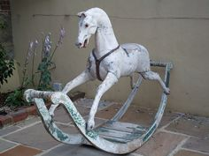 Georgian Bow Rocking Horse~an antique Very rare example of a Georgian Bow Rocking Horse in its original condition. No restoration. Strengtheners to hind legs. All existing paint original.  44 in high, 75 in long