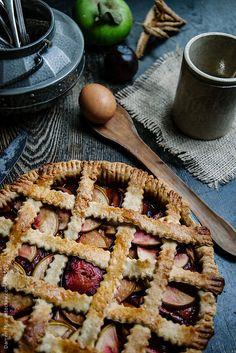 Freshly baked fruit pie. in rustic setting.
