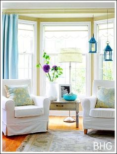how to style and decorate a bay window with 2 chairs and a side table and drapes