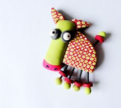 This charming and jaunty little guy will enliven any refrigerator or noteboard! Join our French artist Caroline Cornic as she shows us how to create him! Design by Caroline Cornic