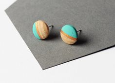 Geomeric stud earrings with gold triangle motif by TheiaDesign