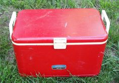Every cottage screened porch needs this: Vintage Thermos red metal cooler that can double as an end table...