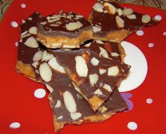 Best-Ever Almond Toffee    1 1/2 cups sliced almonds, divided use  2 sticks unsalted butter — 1/2 pound (salted works too)  1 cup granulated sugar  1/2 cup warm water  1/2 teaspoon salt  1/2 teaspoon baking soda  8 ounces good quality dark or milk chocolate,
