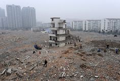 A partially demolished nail house at a construction site in Hefei, Anhui province, China, on February 2, 2010. The owner of the house was attempting to seek more compensation before agreeing to the demolition of their home, local media reported.
