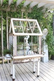 erin's art and gardens: garden folly Garden made out of old windows and filled with garden sculptures and herbs