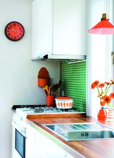 I love the pops of color in this kitchen, and the modern feel with a nice Pyrex hint