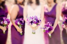 Beautiful white & purple bouquet for the bride complemented by all purple for the bridesmaids.