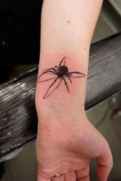 black widow tattoo on wrist