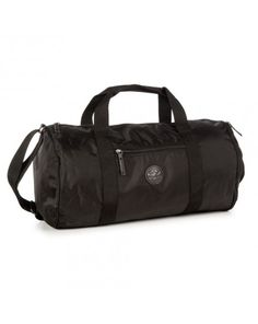 ec352976faa5 Converse Barrel Duffel Bag features a Leather patch Chuck Taylor logo. The  bag can be used as a everyday bag or as an overnight bag.