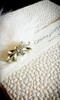 Luxury Pocketfold Wedding Invitation with ivory fluff feather and diamante crystal jewel. Pebble paper, shimmer #luxurywedding #sparklewedding
