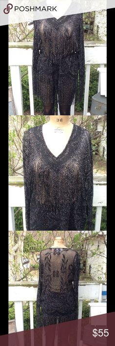 """60s/70s Does Flapper Roaring 20s...Stunning! This is remarkable,it's a very sheer mesh w/metallic silver LUREX thread...tons of fringe on front,sleeve ends and bottom hem,v'd neckline and floral print on the back portion,no closures just slips over your head,it's just Fabulous...it's a Sz 40, by Fantastic New York (Name suits it well) Rayon Poly,made in Japan!! It's in EUC!!! Measurements:L: 35"""" including 9"""" fringe, B:44 w/stretch, SH:dropped, SL:26"""" from drop including fringe, W:22""""…"""