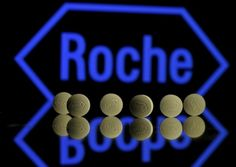 FILE PHOTO:  Roche tablets are seen positioned in front of a displayed Roche logo in this picture illustration, January 22, 2016.  REUTERS/Dado Ruvic/Illustration/File Photo