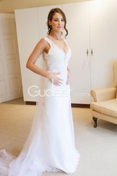Generous pretty v neckline backless spring wedding dress with lace embroidered detail. Dress is double lined in satin with a sheer tulle overlay with lace detail on hem. Mermaid bridal dress is fitted with a soft tulle and lace overlay giving it a beautiful silhouette