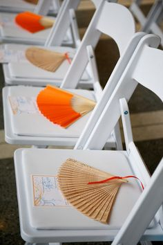 What a fun idea! Coordinate your event or wedding colors with paper fans on each seat. Find fans for sale at splendorforyourguests.com! Splendor for Your Guests | Rental Company | Weddings | Events | Shawls | Blankets | Umbrellas | Parasols | Fans