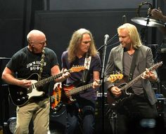 Bernie Leadon, Timothy B. Schmit and Joe Walsh of the Eagles perform during 'History of the Eagles Live in Concert' at the Bridgestone Arena...