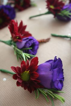 Purple red and orange autumnal buttonhole.