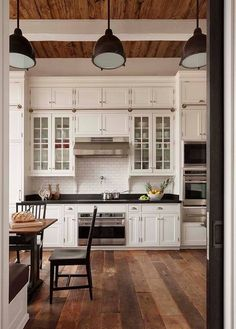 Flooring, ceiling detail, shaker white cabinets. Subway tile, potfiller. Love this