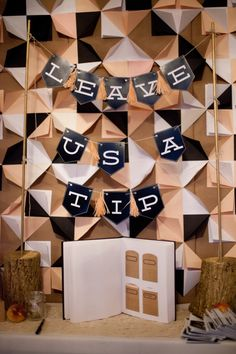 Leave us a tip #guestbook idea with folded paper #backdrop - photo by Lisa Dolan - http://ruffledblog.com/rustic-missouri-wedding/