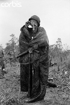 An American soldier with a head injury stands on a hill near Highway 8 waiting for medical helicopters to pick up wounded. South Vietnam. June 8, 1968. (Image by © Bettmann/CORBIS)