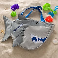 It's a Shark Beach Bag that comes with a beach toy set and you personalize with your kid's name! Plus the other side is mesh so you can shake all the sand out. Perfect for a day at the beach! I kind of love this for the girls, but I want it to be a fish instead of a shark... $29.95