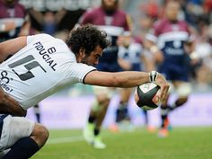 Toulouse's French fullback Yoan Huget reaches to score a try during the French Top 14 rugby union match, Toulouse against Bordeaux, at the Ernest Wallon Stadium in Toulouse. Top 14, Toulouse, Rugby, Bordeaux, French, Sports, Hs Sports, French People, Bordeaux Wine