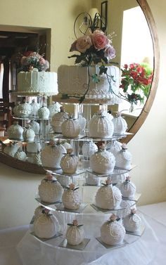 Bauble Mini Wedding Cakes and top cake for cutting looks great in front of the mirror.  Picture taken at Cley Windmill.  For more information about me and my cakes go to www.annescakecreations.co.uk