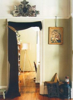 --- a good idea for a studio apartment ----  Eclectic living: draped fabric and mirrored emblem transform this doorway into a grand entrance ---- I am TOTALLY not using my door any longer... It might exist, but My door will be a curtain from now on :D