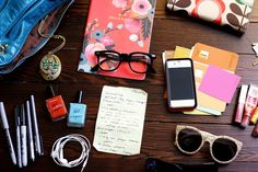 A Beautiful Mess:   Here's what's hanging out in there currently... a journal by Rifle Paper Co, faux nerd glasses (for sleepy face mornings), my locket design forModCloth, Orla Kiely wallet c/o Double Dutch (i LOVE orla!), keys, paint swatches (saving them for a special project, iPhone, lip glosses, sunglasses x 2, a recipe from my grandma, nail color from American Apparel (favorite), headphones, lots of pens (can never have too many!) and scissors (because... you never know)