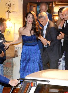 Amal Clooney wowed in a stunning, strapless blue Missoni gown from the designer's Resort 2018 Collection. Amal accessorized the $3,995 frock with dangling earrings, copper-colored shoes and a bold red lip.