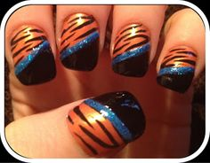detroit tiger nails: I did all orange with tiger stripes then my thumb I did navy with the Detroit D on it. Tiger Stripe Nails, Tiger Nail Art, Tiger Nails, Striped Nails, Tiger Stripes, Fingernail Designs, Cute Nail Designs, Cute Nails, Pretty Nails