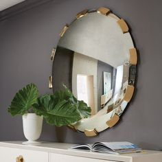 The RoundAplique Mirror from Modern History presents a sophisticated and interesting design that is uniquelymodern. The ApliqueMirrorfeatures satin brass pi