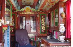 Vardo interiors may be rich in frills, lace, or cut glass. This is the     interior of a wagon built for Swales Forest of Kent in 1906 by John     Rudderham of Leytonstone, London. A wall pulls out to form the bunk.