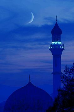 the Islamic crescent moon nest to that minaret...so pretty.