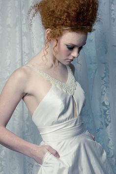 Love the beaded neckline and key hole cut out on this lovely #wedding dress from Pantora Bridal.
