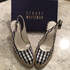 STUART WEITZMAN navy gingham espadrilles STUART WEITZMAN 'Gosling' navy & white gingham espadrilles. Only worn a few times. Other than a slight orange discoloration on the outer right shoe (maybe from storing?) which might come off with a good scrub, these are in GREAT condition! Perfect for summer! Pair with your fave dress or crops! Includes box. Stuart Weitzman Shoes Espadrilles
