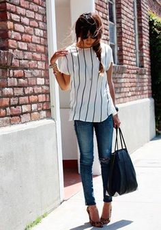Shop this look on Lookastic:  https://lookastic.com/women/looks/short-sleeve-blouse-skinny-jeans-pumps-tote-bag-sunglasses-watch/12496  — Black Sunglasses  — Gold Watch  — White and Black Vertical Striped Short Sleeve Blouse  — Blue Ripped Skinny Jeans  — Black Leather Tote Bag  — Tan Leopard Suede Pumps