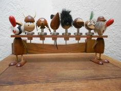A Han Bolling style teak mid century bar bottle stopper set.  Is this cute and kitschy or too much?
