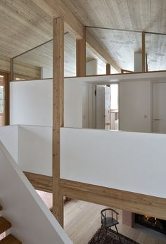 Rothaus | Jonathan Tuckey Design, Andermatt, Switzerland. A cantilevered staircase, constructed from larch timber plywood, a specially engineered timber for its strength. A natural plaster was applied to sheet ply to create the balustrade.
