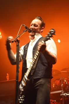 Michael Poulsen in a warm, orange backdrop. Photo by Tiffani Henry.