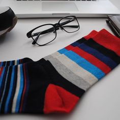 Our desk essentials of the day. Funky socks are a must!