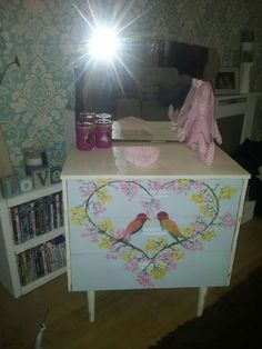 Hand painted birds in love heart foliage