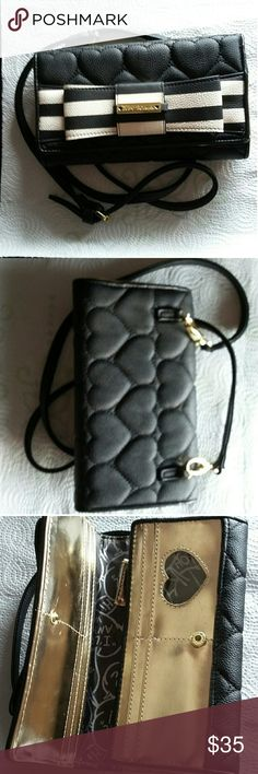 """Betsey Johnson Cross Body Purse w/detachable strap Snap closure. 13 spots for credit cards and 1 spot for ID to be seen. One zippered closure that separates the wallet. Two areas for paper money as well. Measures 8""""x5"""" and the strap has a 23"""" drop. Betsey Johnson Bags Crossbody Bags"""