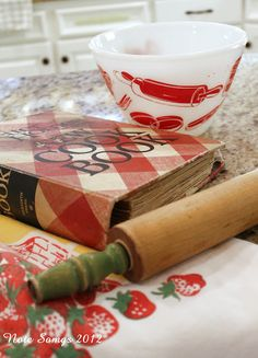 vintage kitchen. I have the exact cookbook and rolling pin...now to find the bowl! <3