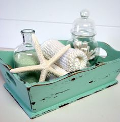 Great for a beach house guest room or bathroom decor. Wood tray starfish shells in a&; Great for a beach house guest room or bathroom decor. Wood tray starfish shells in a&;