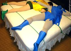 a gay super heros asleeping together in bed