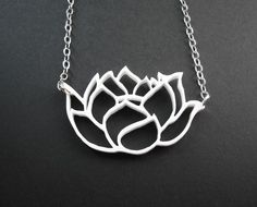 Laser cut acrylic lotus flower pendant. $33.00, via Etsy.