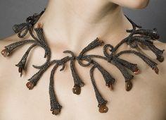collier métal tricot